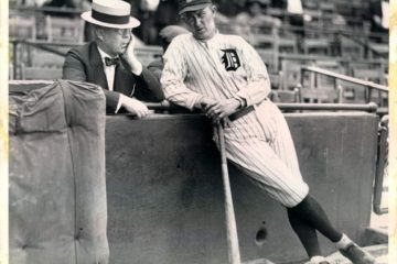 Player-manager Ty Cobb and owner Frank Navin confer at Navin Field in 1921