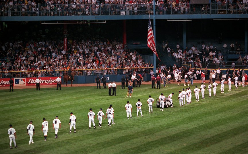 The flag is lowered at Tiger Stadium after the final game in 1999 (Photo by Steve Jessmore)